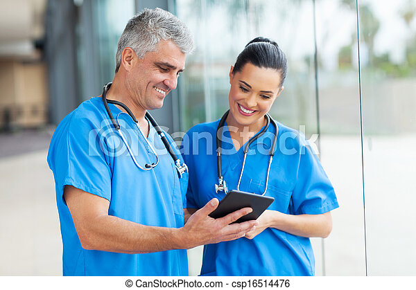 healthcare workers using tablet computer - csp16514476