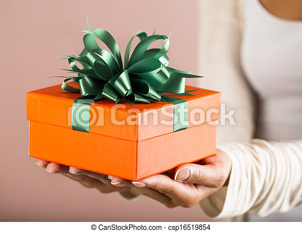 Hands holding beautiful gift box
