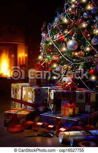 Art Christmas Tree and Christmas gift boxes in the interior with a fireplace - csp16527755