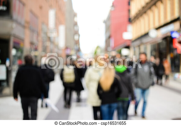 Crowd of shopping people in the city - csp16531655