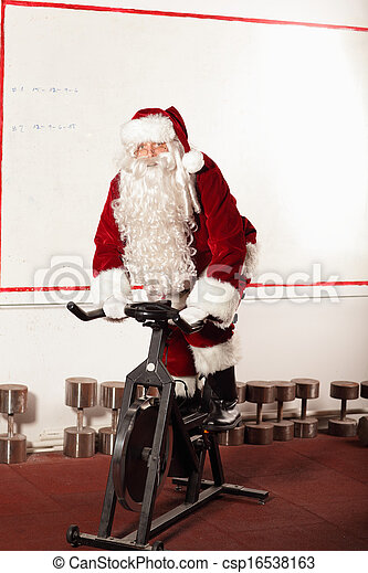 Santa Claus training on bike - csp16538163