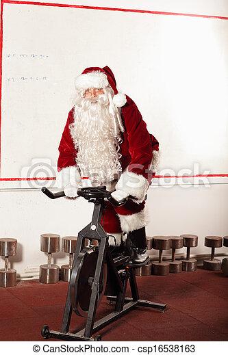 Santa Claus training on bike - csp16538163