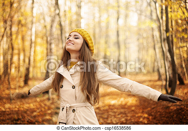 Young woman enjoying nature at autumn - csp16538586