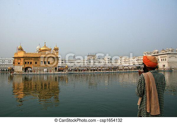 Sikh Man Praying at Golden Temple - csp1654132
