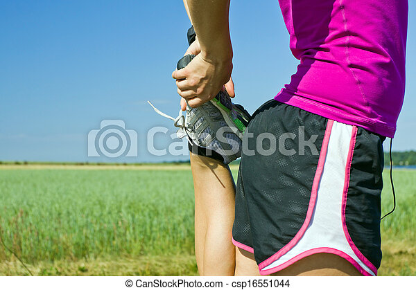 Woman runner stretching outdoors - csp16551044