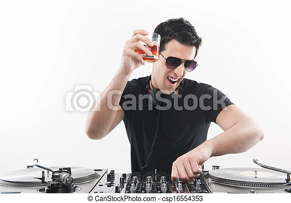 Cool DJ at the turntable. Happy young men spinning on turntable and drinking while isolated on white - csp16554353