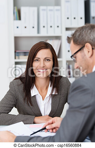 Smiling businesswoman in a meeting - csp16560884