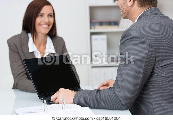 Businessman using a laptop computer - csp16561204
