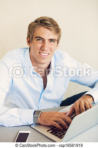 Professional Young Man Working on Laptop Computer  - csp16561919