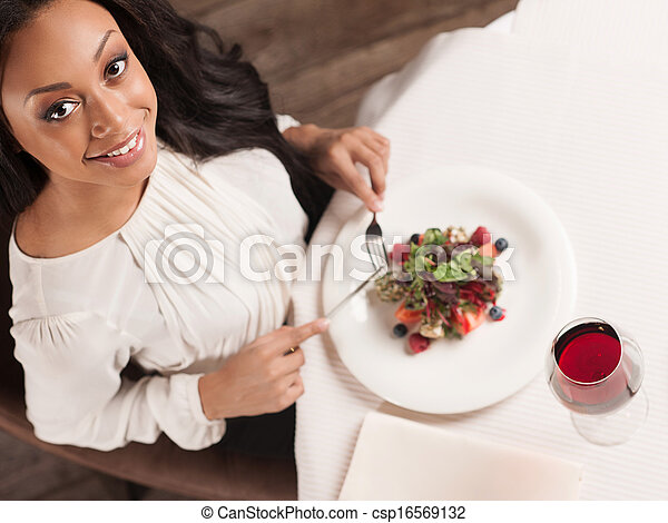 Beauty at the restaurant. Top view of beautiful African descent women enjoying dinner at the restaurant - csp16569132
