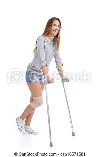 Beautiful woman smiling and hobbling with crutches - csp16571581