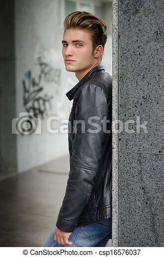 Attractive blond young man in city environment - csp16576037