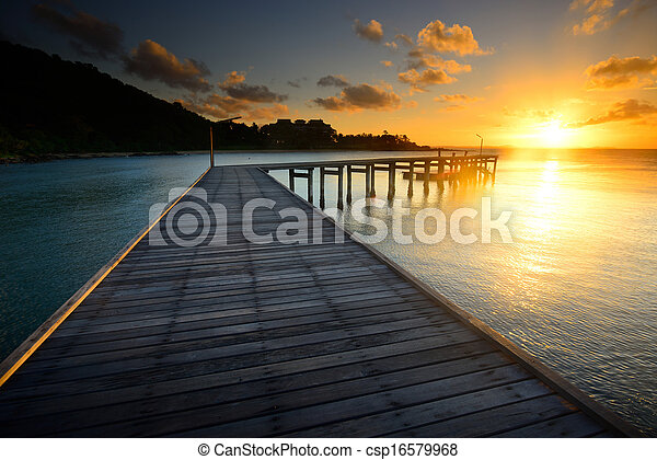 The beautiful wooden pier with sunrise at Rayong, Thailand - csp16579968