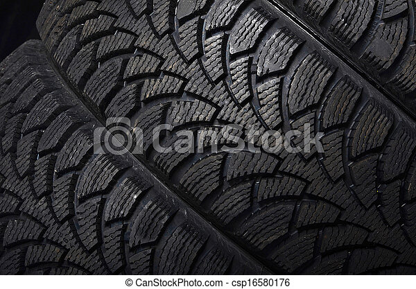 The automobile tire on black background - csp16580176