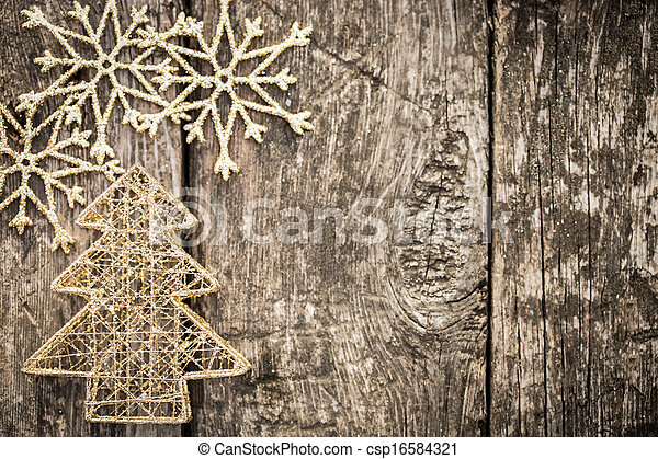 Gold Christmas tree decorations on grunge wood - csp16584321
