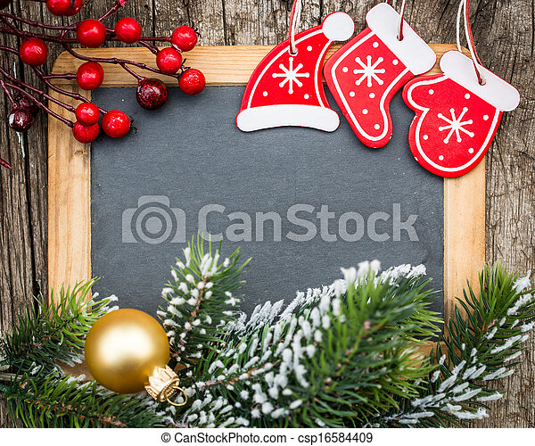 Vintage wooden blackboard blank framed in Christmas tree branch and decorations. Winter holidays concept. Copy space for your text - csp16584409