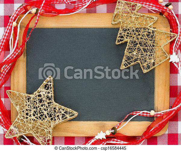 Christmas tree decorations on vintage wooden blackboard
