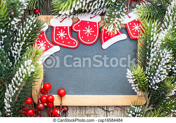 Blackboard blank framed in beautiful Christmas tree branches and decorations. Winter holidays concept. Copy space for your text - csp16584484
