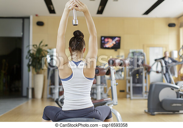 Young woman training in the gym - csp16593358