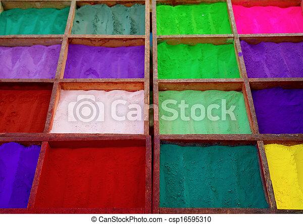 Bright colored tika powder used in Hindu religion - csp16595310