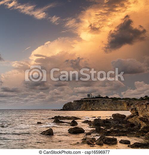 Dawn sunrise landscape over beautiful rocky coastline in Mediterranean Sea - csp16596977