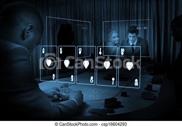 Room of people gambling on table with holographic card display in blue light in dark room - csp16604293