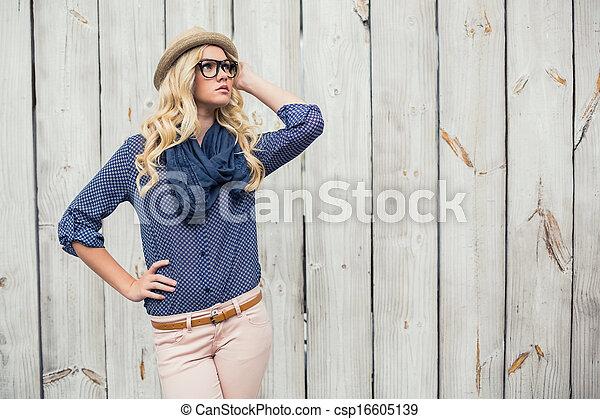 Day dreaming trendy model posing