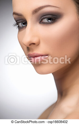 Beautiful make-up. Portrait of confident women with make-up looking at camera while isolated on grey - csp16608402