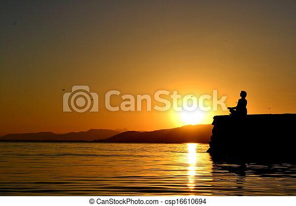 Meditation at sunset - csp16610694