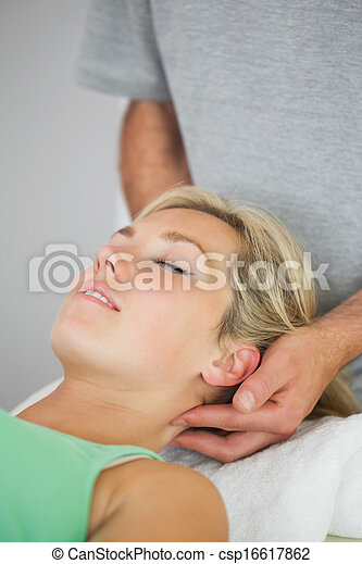 Physiotherapist holding patients head - csp16617862
