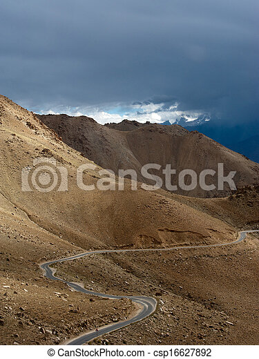 Empty rural road going through Himalaya high mountain landscape panorama with dramatic cloudy sky. India, Ladakh - csp16627892