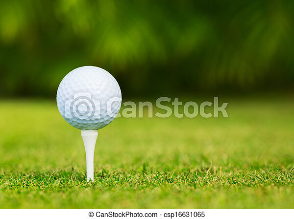 Close up view of golf ball on tee on golf course - csp16631065