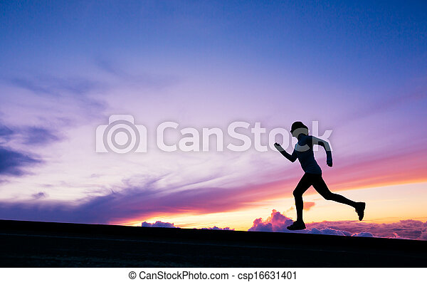 Female runner silhouette, running into sunset - csp16631401