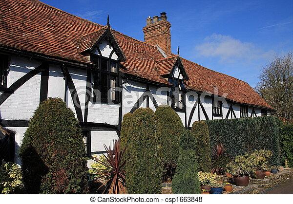 Attractive whitewashed cottage - csp1663848
