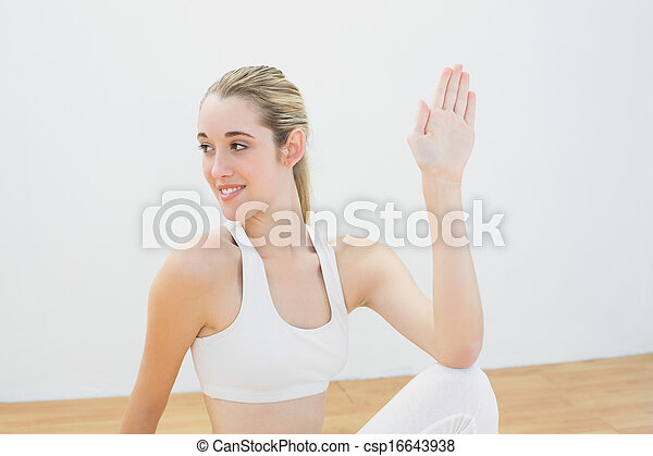 Happy calm woman stretching her body sitting on floor  - csp16643938