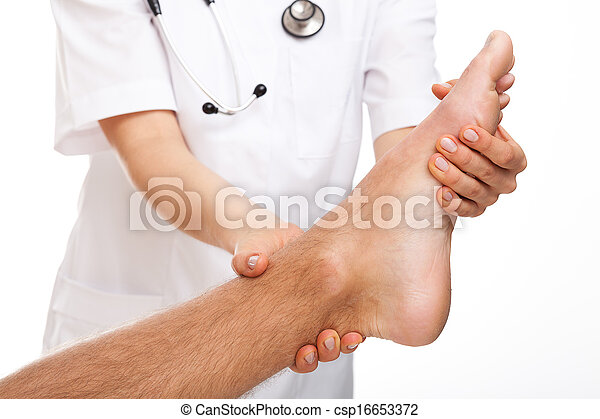 Physician examining painful foot - csp16653372