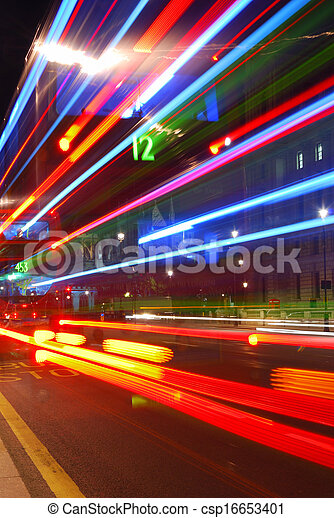 Abstract colorful light trails from traffic in the city center - csp16653401