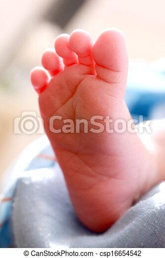The feet of newly born baby