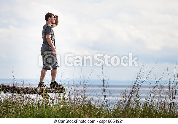 Young Adult in Nature Looking at The View - csp16654921