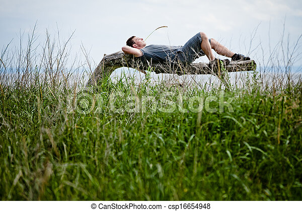 Young Adult Relaxing Peacefully in Nature - csp16654948