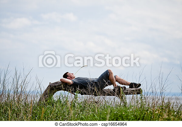Young Adult Relaxing Peacefully in Nature - csp16654964