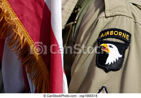 US soldier and flag of Airborne division - csp1665518