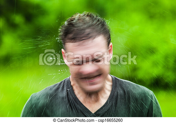 Young Adult Completely Drenched Shaking His head - csp16655260
