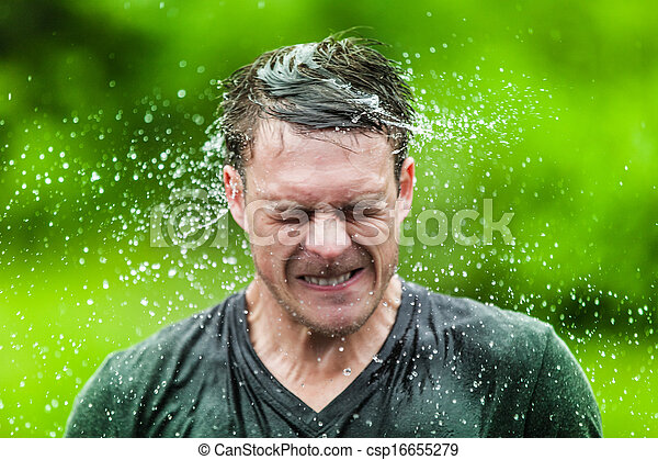Young Adult Completely Drenched Shaking His head - csp16655279