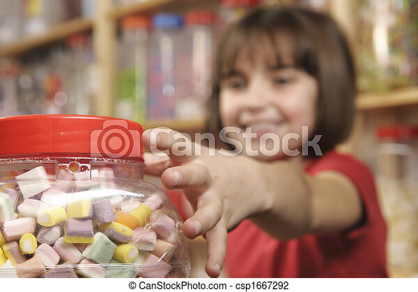 child in sweet shop - csp1667292