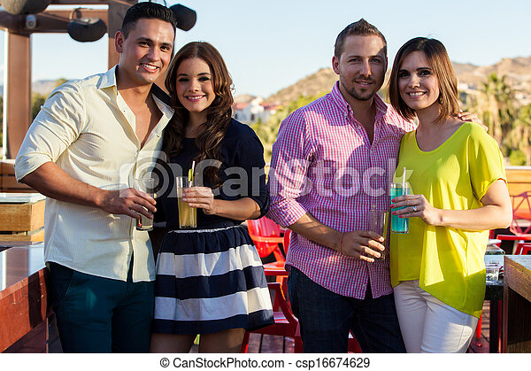 Young adult couples hanging out - csp16674629