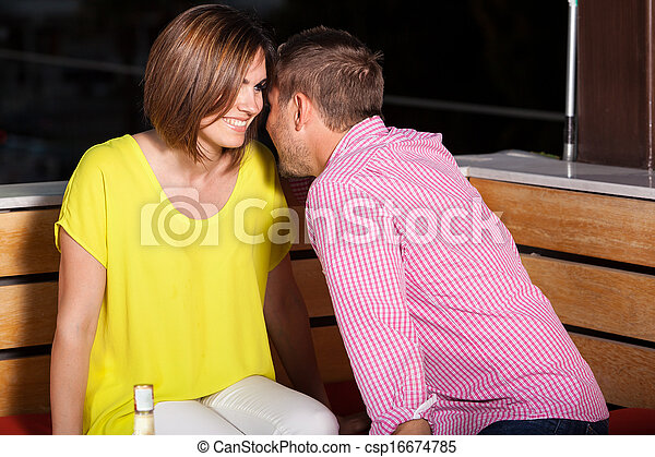 Young adults flirting at a bar - csp16674785