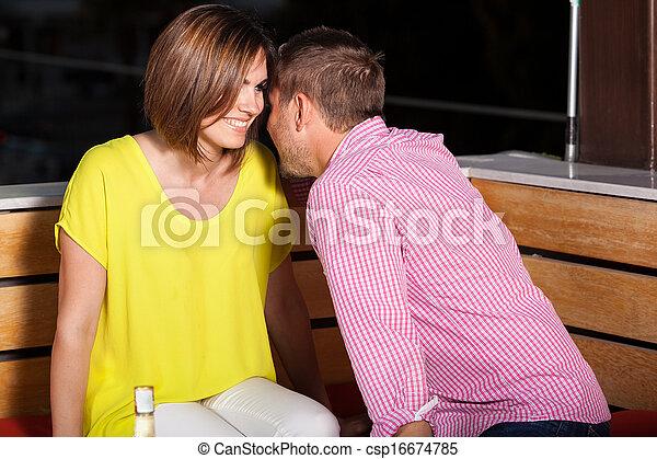 Young adults flirting at a bar - csp16674785