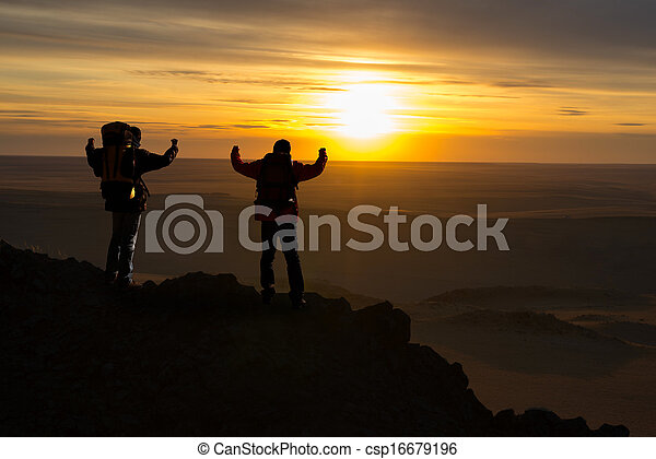 Travelers at the top of the mountain - csp16679196