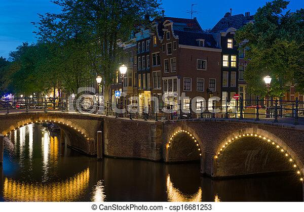 Bridges in Amsterdam at night - csp16681253